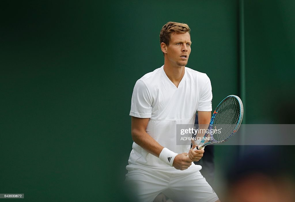Czech Republic's Tomas Berdych prepares to return to Croatia's Ivan Dodig during a men's singles first round match on the third day of the 2016 Wimbledon Championships at The All England Lawn Tennis Club in Wimbledon, southwest London, on June 29, 2016. / AFP / ADRIAN