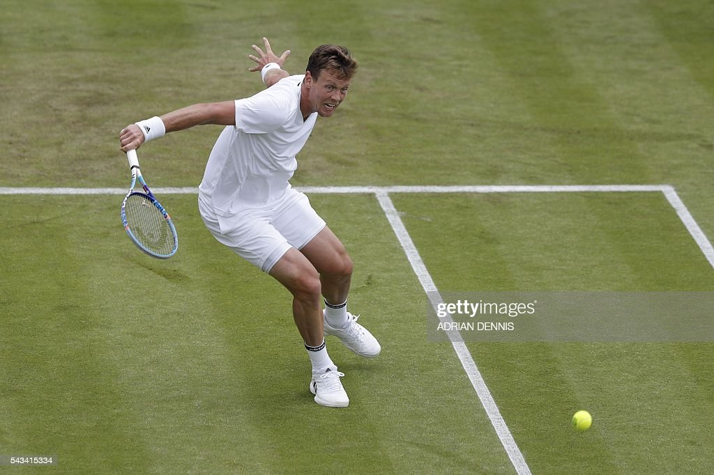 Czech Republic's Tomas Berdych returns against Croatia's Ivan Dodig during their men's singles first round match on the second day of the 2016 Wimbledon Championships at The All England Lawn Tennis Club in Wimbledon, southwest London, on June 28, 2016. / AFP / ADRIAN