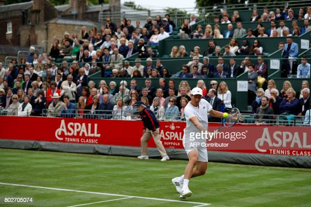 Czech Republic's Tomas Berdych returns against Spain's Rafael Nadal during his men's singles match at The Hurlingham Tennis Classic tournament at the...