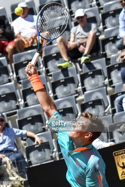 Czech Republic's Tomas Berdych returns the ball to Germany's Mischa Zverev during their ATP Tennis Open tournament match on May 15 2017 at the Foro...