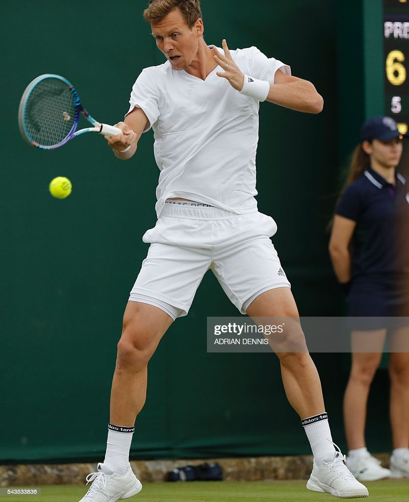 Czech Republic's Tomas Berdych returns to Croatia's Ivan Dodig during a men's singles first round match on the third day of the 2016 Wimbledon Championships at The All England Lawn Tennis Club in Wimbledon, southwest London, on June 29, 2016. / AFP / ADRIAN