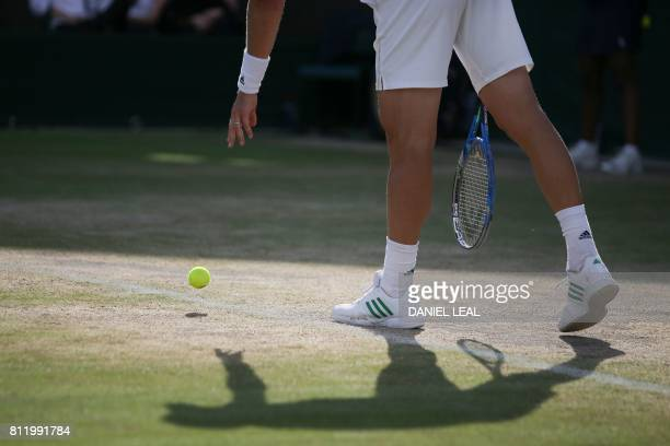 Czech Republic's Tomas Berdych serves against Austria's Dominic Thiem during their men's singles fourth round match on the seventh day of the 2017...