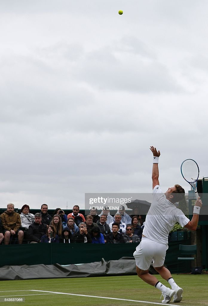Czech Republic's Tomas Berdych serves to Croatia's Ivan Dodig during a men's singles first round match on the third day of the 2016 Wimbledon Championships at The All England Lawn Tennis Club in Wimbledon, southwest London, on June 29, 2016. / AFP / ADRIAN