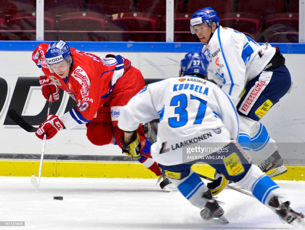 Czech Republic's Tomas Hertl (L) surrounded by Finland's Kristian Kuusela (C) and Petteri Wirtanen (R) during the ice hockey match between Finland and Czech Republic in the Oddset Hockey Games at Malmo Arena in Malmo, on February 9, 2013.