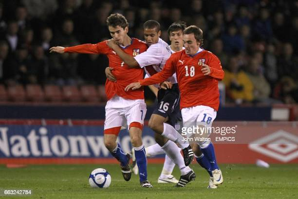 Czech Republic's Tomas Horava and Martin Zeman challenge England's Kyle Naughton for the ball
