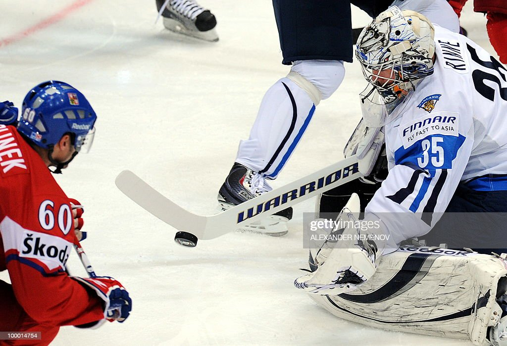 Czech Republic's Tomas Rolinek (L) and Finland's Pekka Rinne vie during the IIHF Ice Hockey World Championship quarter-final match Finland vs Czech Republic in the western German city of Cologne on May 20, 2010. The 2010 IIHF Ice Hockey World Championships are taking place in Germany from May 7 to 23, 2010.