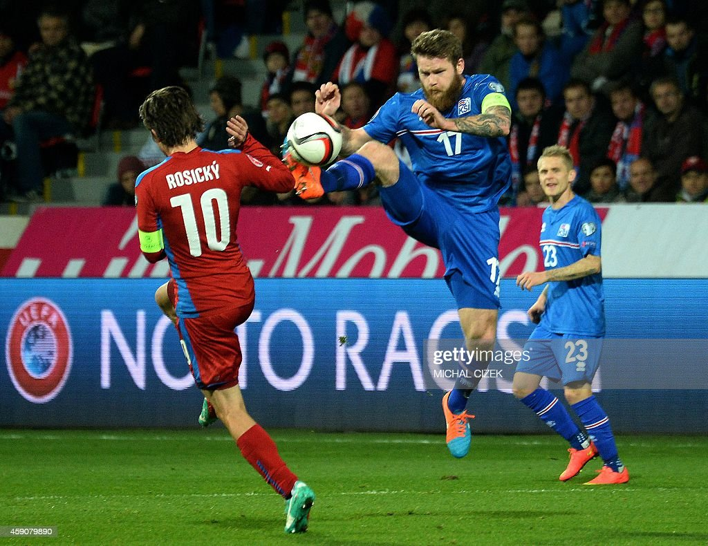 Czech Republic's Tomas Rosicky and Iceland's Aron Gunnarsson vie for the ball during the UEFA 2016 European Championship qualifying round Group A...