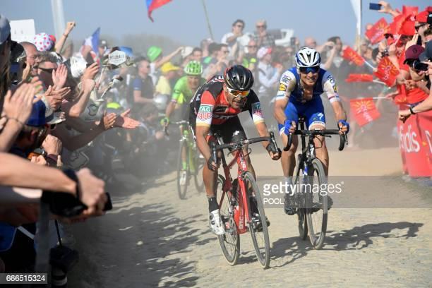 Czech Republic's Zdenek Stybar Belgium's Greg Van Avermaet and Netherlands' Sebastian Langeveld ride on the cobblestones in a breakaway during the...