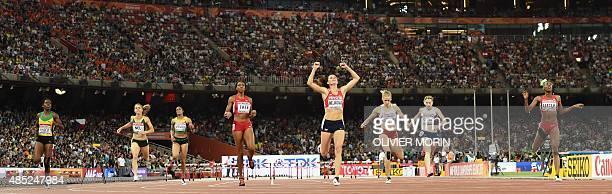 Czech Republic's Zuzana Hejnova celebrates as she crosses the finishline ahead of Jamaica's Janieve Russell South Africa's Wenda Nel Jamaica's...