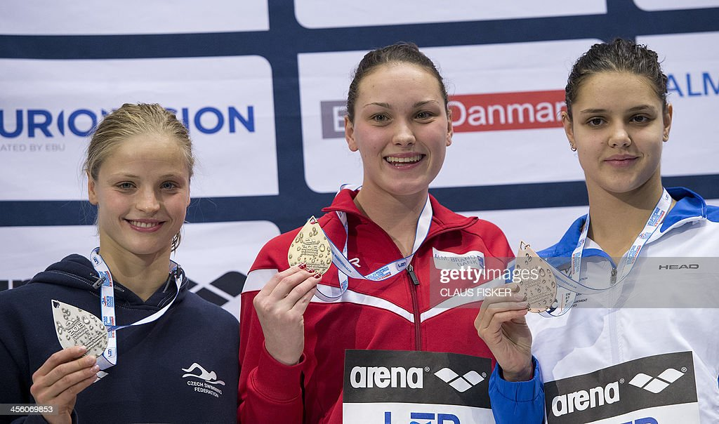 Czech Simona Baumrtova (2nd), winner Denmark's <a gi-track='captionPersonalityLinkClicked' href=/galleries/search?phrase=Mie+Nielsen&family=editorial&specificpeople=3000359 ng-click='$event.stopPropagation()'>Mie Nielsen</a> and Ukraine's Daryna Zevina (3rd) celebrate after the 100m Backstroke event of the Len European Short Course Swimming Championships in Herning, Denmark, December 13, 2013.