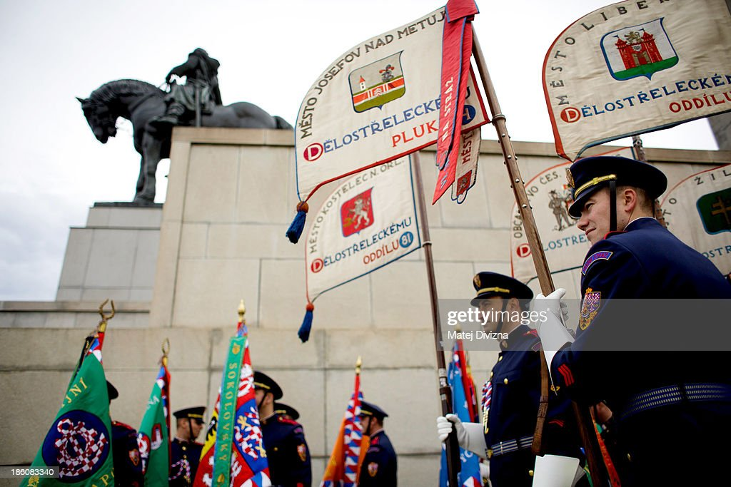 Czech soldiers hold historic flags next to the National Memorial as they prepare for an Independence Day ceremony at Vitkov Hill on October 28, 2013 in Prague, Czech Republic. The Czech Republic is marking the 95th anniversary of the creation of an independent Czechoslovak nation in 1918.