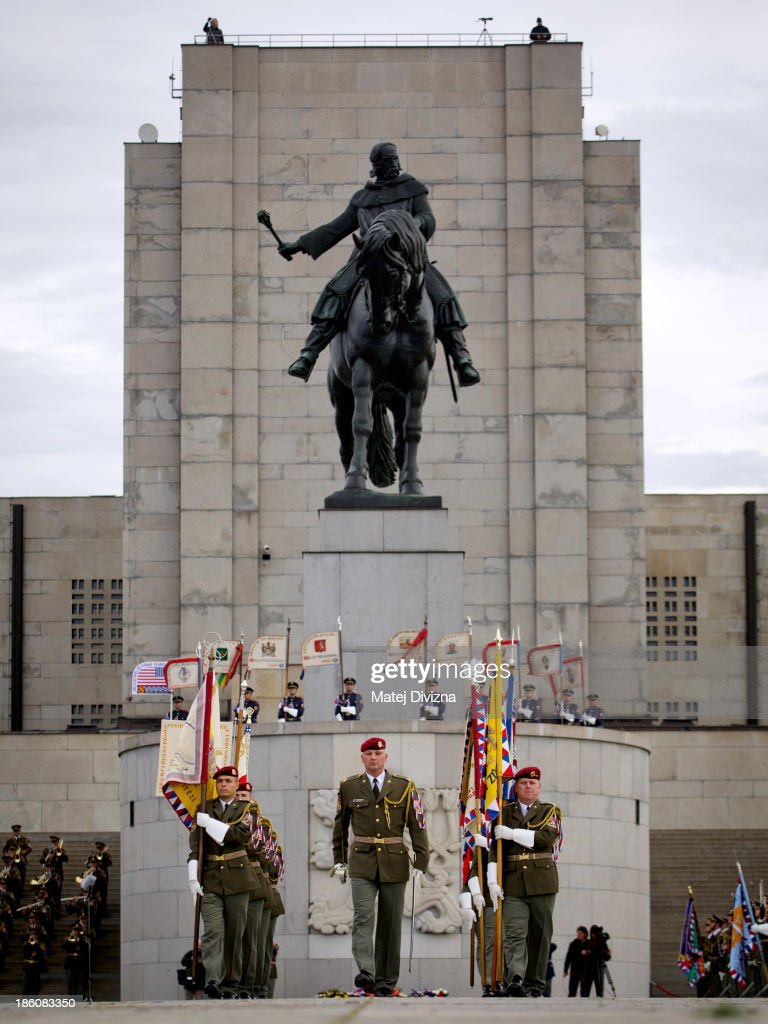 Czech soldiers march carrying historic flags during an Independence Day ceremony at Vitkov hill on October 28, 2013 in Prague, Czech Republic. Czech Republic mark the 95th anniversary of the creation of the independent Czechoslovakia state in 1918.