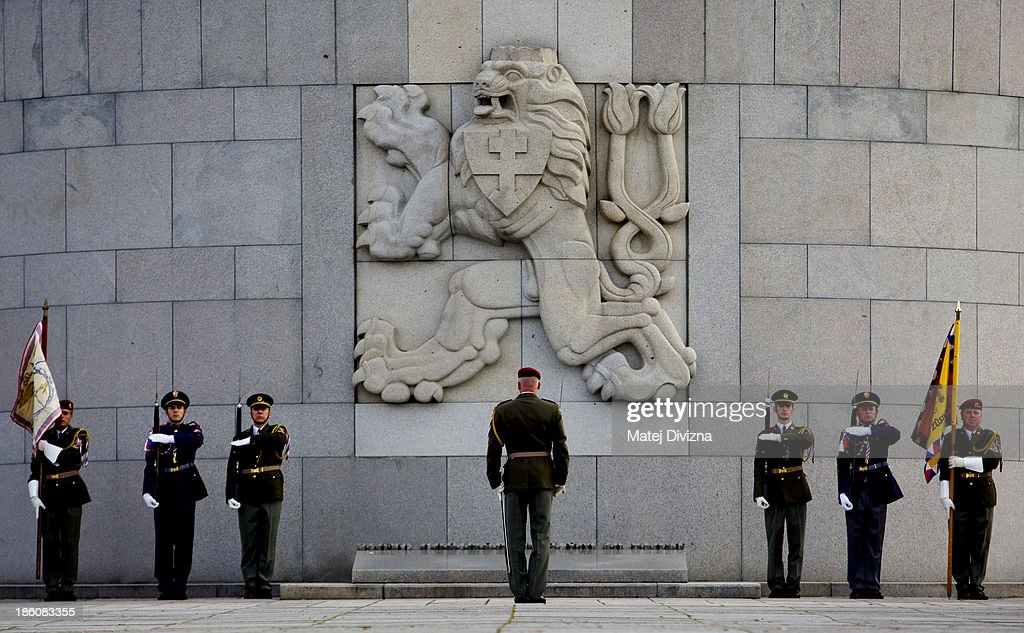 Czech soldiers stand in front of the National Memorial during an Independence Day ceremony at Vitkov Hill on October 28, 2013 in Prague, Czech Republic. The Czech Republic is marking the 95th anniversary of the creation of an independent Czechoslovak nation in 1918.