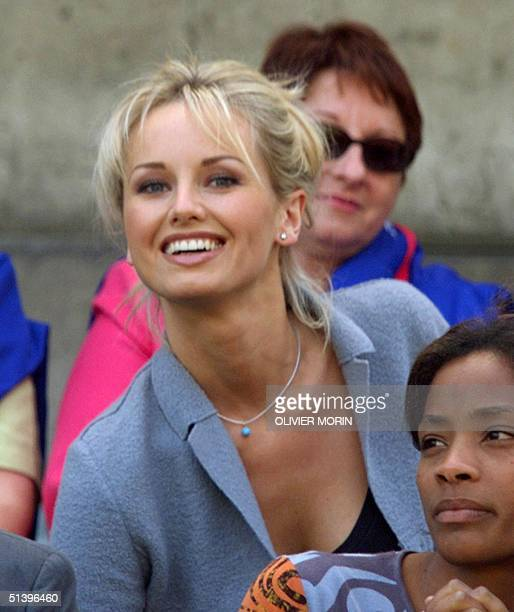 Czech supermodel Adriana Karembeu watches the game during the Euro2000 Group D first round match between France and the Czech Republic 16 June 2000...