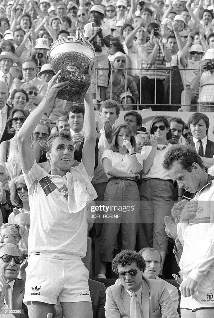 Czech tennis player Ivan Lendl (L) presents the cup he just received for his victory against top-seeded McEnroe in the men's final of the French Tennis Open in Roland Garros in Paris 10 June 1984 as American player looks down. Ivan Lendl won 3-6, 2-6, 6-4, 7-5, 7-5.