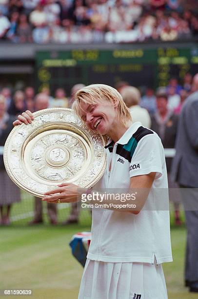 Czech tennis player Jana Novotna embraces the Venus Rosewater Dish trophy after winning the final of the Women's Singles tournament against Nathalie...