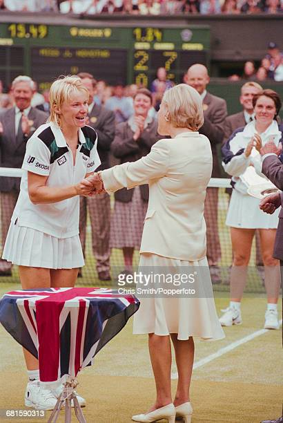 Czech tennis player Jana Novotna is presented with the Venus Rosewater Dish trophy by Katharine Duchess of Kent after winning the final of the...