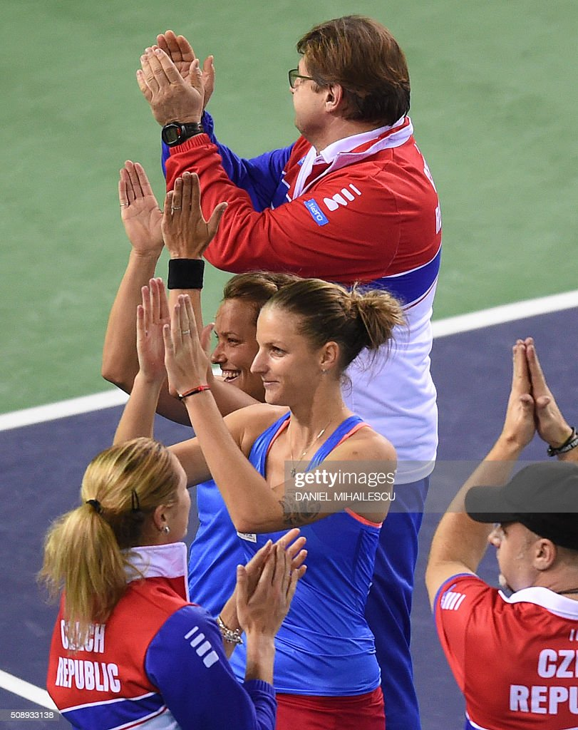 Czech tennis team celebrates victory over Romania in the FedCup World Cup first round tennis match at 'Sala Polivalenta Cluj Napoca' hall in Cluj Napoca city February 7, 2015. / AFP / DANIEL MIHAILESCU