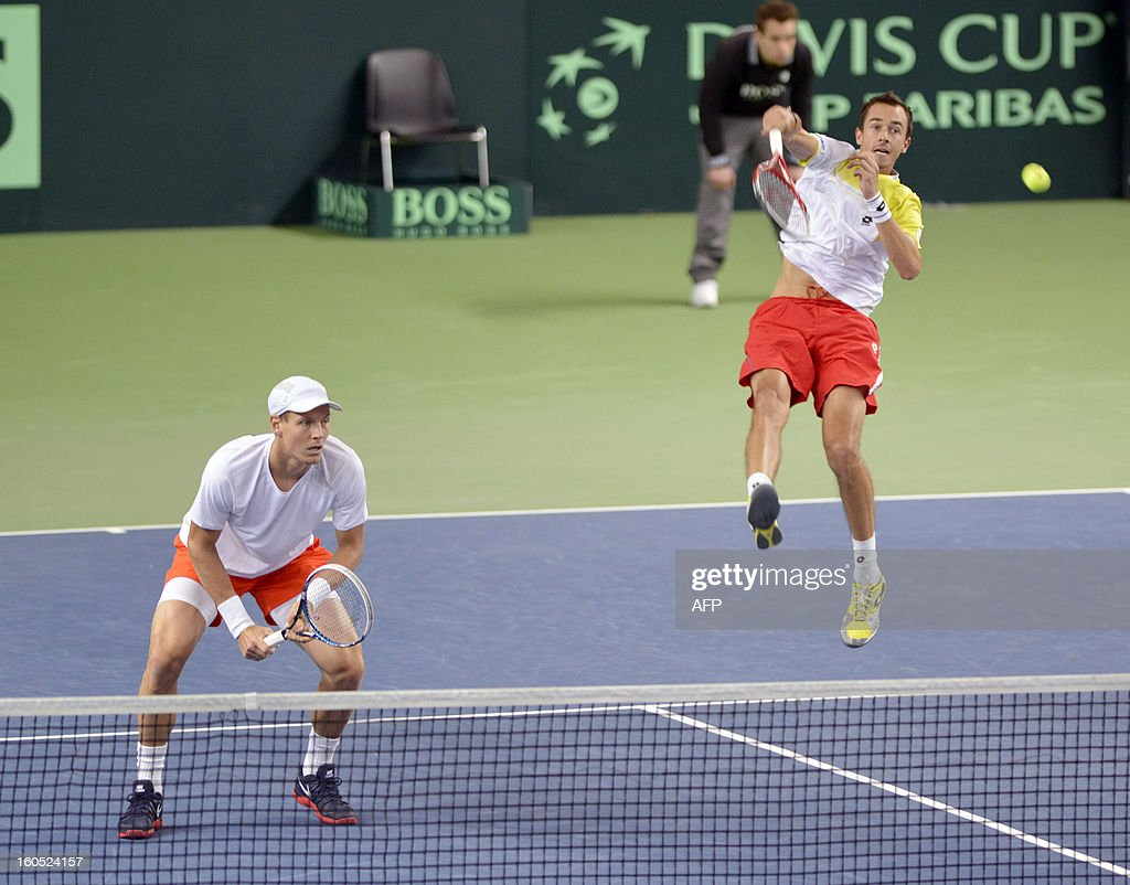 Czech Tomas Berdych (L) and Lukas Rosol play against Swiss' Stanislas Wawrinka and Marco Chiudinelli in the Davis Cup World Group first round game between Switzerland and title owner the Czech Republic on February 2, 2013 in Geneva.