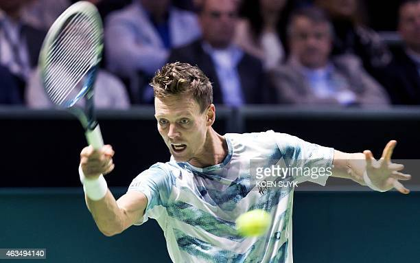 Czech Tomas Berdych returns the ball against Swiss Stan Wawrinka on February 15 2015 during the final at the ABN AMRO Tennis Tournament in Ahoy...