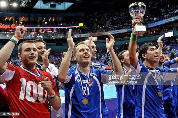 Czech Tomas Chrapek jubilates with his teammates after beating Switzerland in the World Floorball Championship 2010 bronze medal game between Czech...
