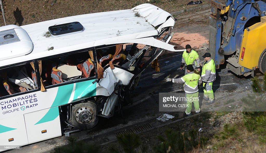 Czech traffic technicians inspect the bus of French transportation company RATP as it stands crashed on highway D5 near Rokycany, Czech Republic, on April 08, 2013. 41 passengers were injured, one mortally, in the accident of a French bus on its way to Prague.