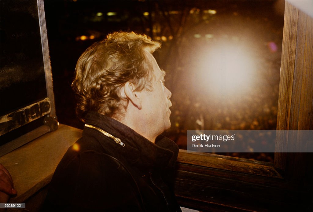 Czech writer, dissident, and statesman Václav Havel (1936 - 2011) looks out on people demonstrating in Wenceslas Square for greater liberty and the resignation of General Secretary of the Communist Party of Czechoslovakia, Miloš Jakeš, Prague, 22nd November 1989.