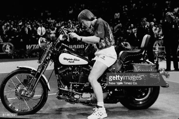 Czechborn American tennis player Martina Navratilova sits on a HarleyDavidson motorcycle at the Virginia Slims tournament in New York November 15 1994