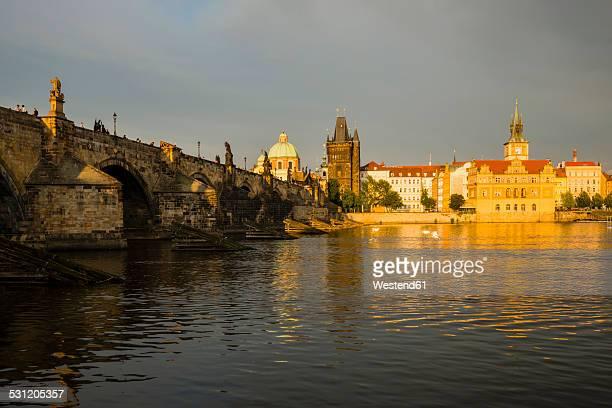 Czechia, Prague, Charles Bridge, Old Town Bridge Tower and Bedrich Smetana Museum in the evening