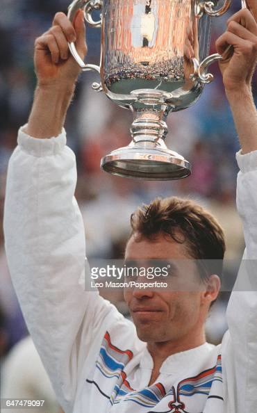 Czechoslovak tennis player Ivan Lendl holds up the US OpenTrophy after defeating Miloslav Mecir in the final of the 1989 US Open Men's Singles tennis...