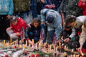 Czechoslovakians light candles at a shrine on the spot where students were injured during the Velvet Revolution in Prague Czechoslovakia