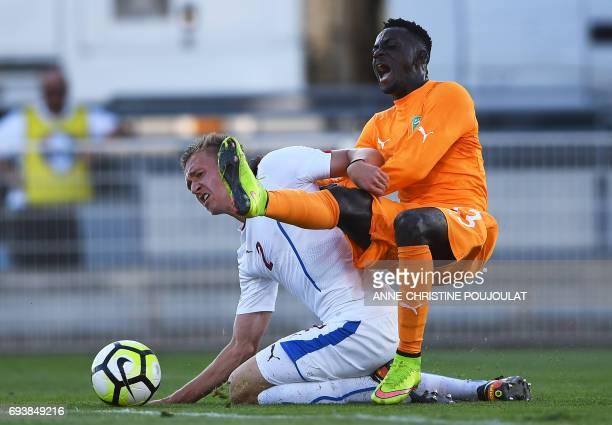 Czech's defender Pavel Tkac vies with Ivory Coast's forward Ake Arnaud Loba during the Under 21 international football semi final match Ivory Coast...