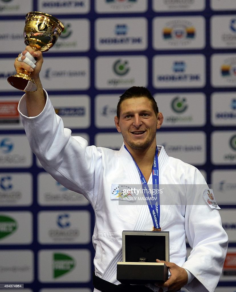 Czech's judoka <a gi-track='captionPersonalityLinkClicked' href=/galleries/search?phrase=Lukas+Krpalek&family=editorial&specificpeople=6589582 ng-click='$event.stopPropagation()'>Lukas Krpalek</a> holds his trophy on the podium after winning the gold medal in the -100kg category competition at the World Judo Championships in Chelyabinsk, on August 30, 2014.