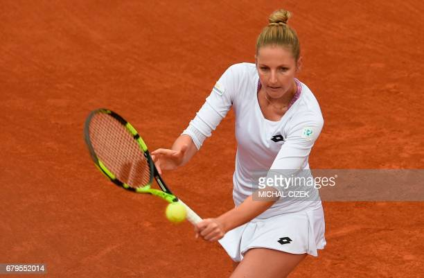Czech's Kristyna Pliskova returns the ball to German Mona Barthel during their final tennis match at the Prague Open on May 6 2017 in Prague / AFP...