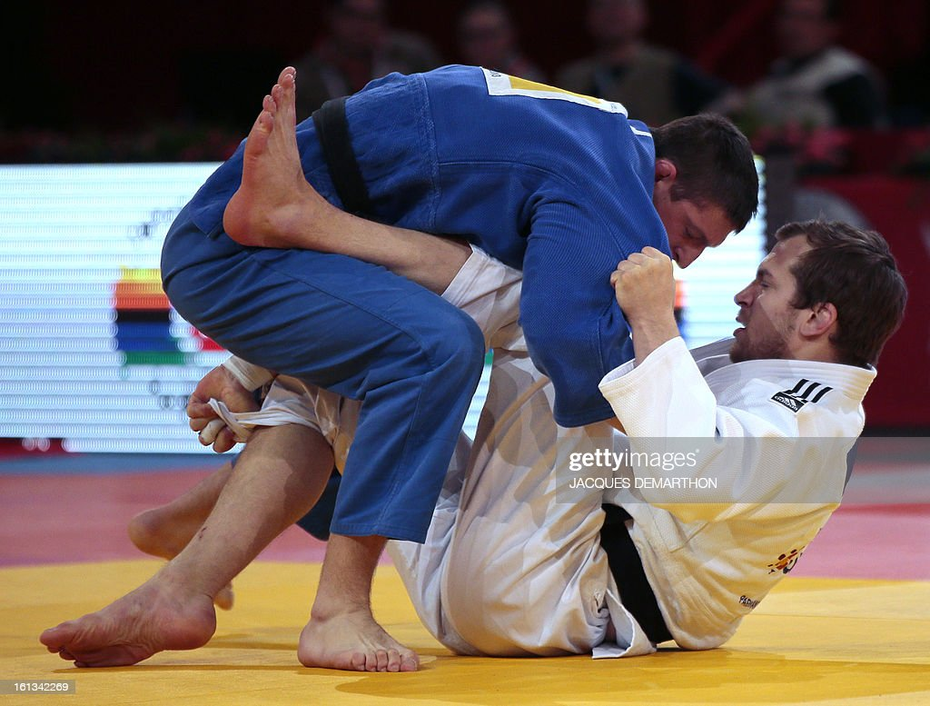 Czech's Lukas Krpalel (Top) competes with Sweden's Martin Pacek on February 10, 2013 in the men's under 100kg category qualifying fight during the Paris International Judo tournament, part of the Grand Slam, at the Palais Omnisports de Paris-Bercy (POPB).