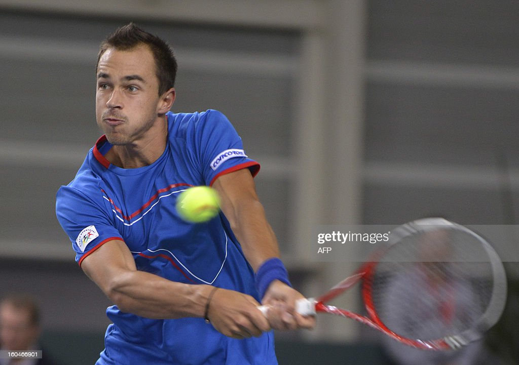 Czech's Lukas Rosol returns the ball to his Swiss opponent Stanislas Wawrinka during a Davis Cup World Group first round tennis match Switzerland vs Czech Republic on February 1, 2013 in Geneva.