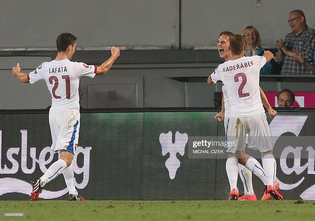 Czech's midfielder Borek Dockal celebrates with Czech's striker David Lafata and Czech's defender Pavel Kaderabek after scoring during the UEFA Euro...