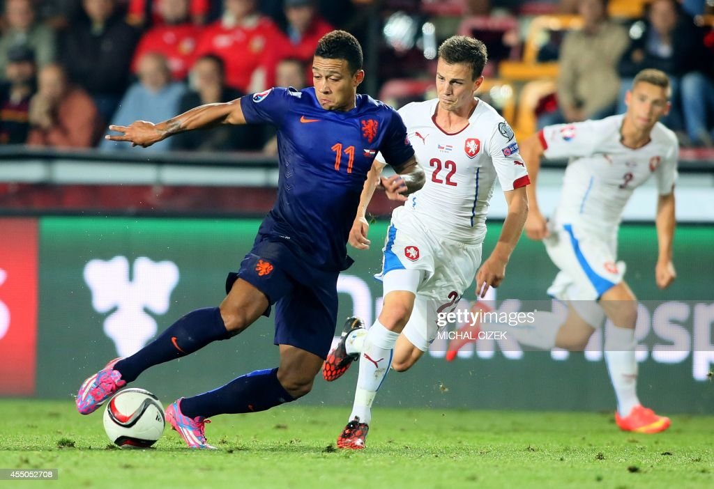 Czech's midfielder Vladimir Darida and Netherland's forward Memphis Depay vie for the ball during the UEFA Euro 2016 Group A qualifying football...