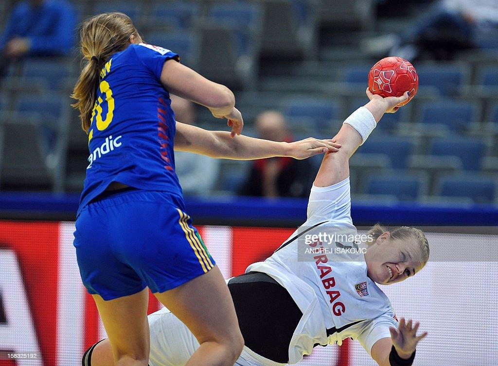Czech's Romana Chrenkova (L) vies with Sweden's Isabelle Gullden (R) during their Women's EHF Euro 2012 Handball Championship match Czech Republic vs Sweden on December 13, 2012, at the Belgrade Arena.
