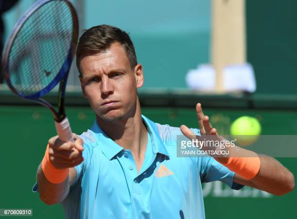 Czechs Tomas Berdych hits a return to Croatias Marin Cilic during their MonteCarlo ATP Masters Series tennis tournament on April 20 2017 in Monaco /...