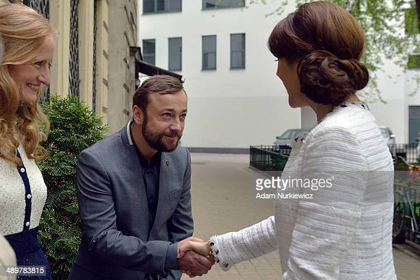 Czeslaw Mozil Polish singer composer and musician graduate of the Royal Danish Academy of Music greets Crown Princess Mary of Denmark during her...