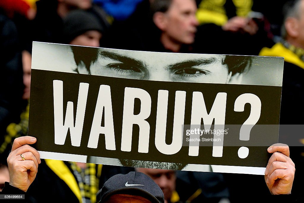 Da Fan shows a sign 'Warum?' according to Mats Hummels during the Bundesliga match between Borussia Dortmund and VfL Wolfsburg at Signal Iduna Park on April 29, 2016 in Dortmund, Germany.