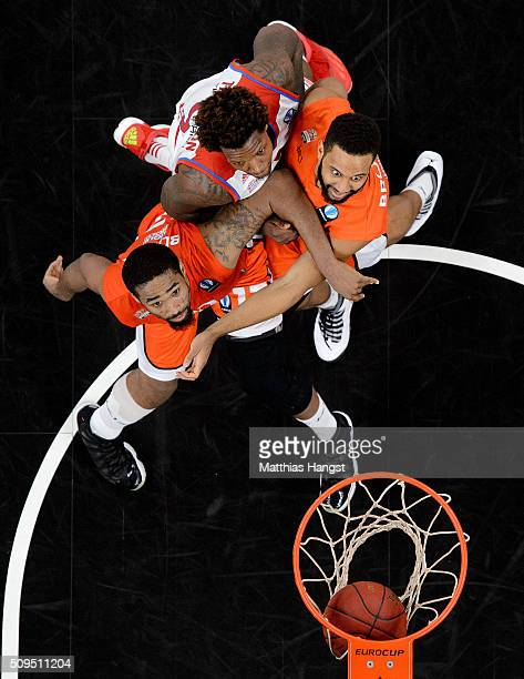 Da Saen Butler of Ulm and Carlon Brown of Ulm block Deon Thompson of FC Bayern Muenchen during the Eurocup Basketball match between ratiopharm Ulm...