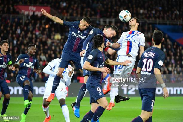 Da Silva Rafael of Lyon out jumps Julian Draxler and Marquinhos of PSG during the French Ligue 1 match between Paris Saint Germain and Lyon at Parc...