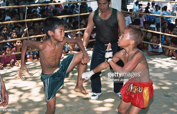 Da Wang a tenyearold Thai schoolboy at a fight in Mae Kon Ken village close to the ThaiBurmese border Da Wang fought the Burmese boxer for three...