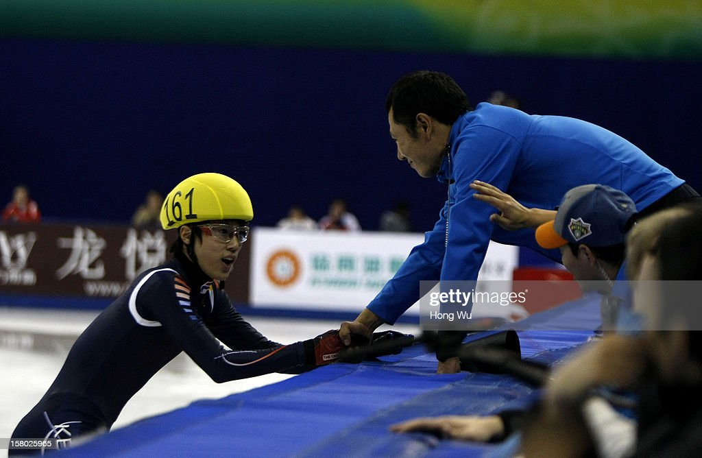 Da Woon Sin of Korea shakes hands with his coach after won in the Men's 5000m Relay Final during the day two of the ISU World Cup Short Track at the Oriental Sports Center on December 9, 2012 in Shanghai, China.