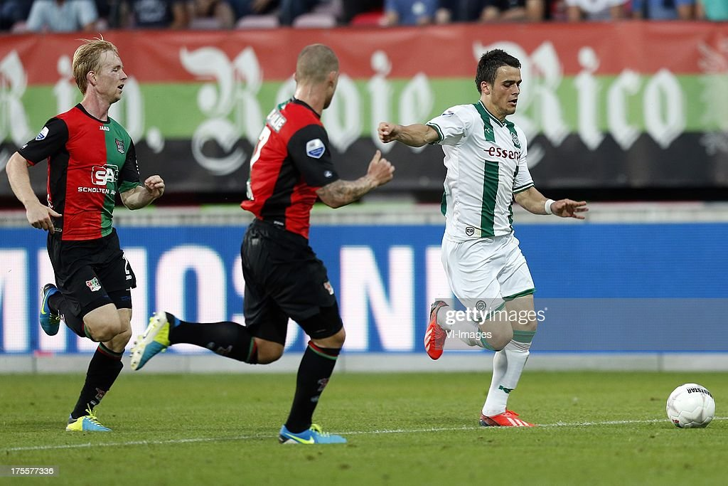 Daan Bovenberg of NEC Filip Kostic of FC Groningen during the Dutch Eredivisie match between NEC Nijmegen and FC Groningen on August 3 2013 at the...