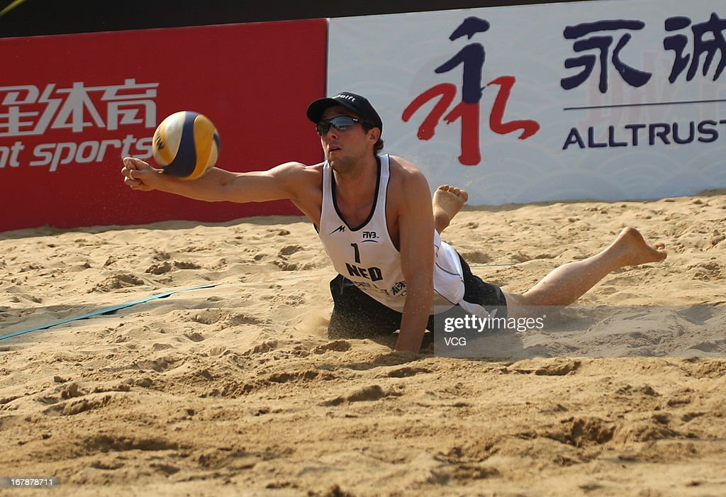 Daan Spijkers of The Netherlands in action against Pedro Solberg Salgado and Bruno Oscar Schmidt of Brazil during the men's main draw of FIVB Beach Volleyball Shanghai Grand Slam at Jinshan City Beach on May 1, 2013 in Shanghai, China.
