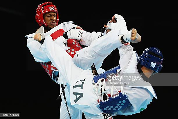 Daba Modibo Keita of Mali competes against Carlo Molfetta of Italy during the semifinal on Day 15 of the London 2012 Olympic Games at ExCeL on August...