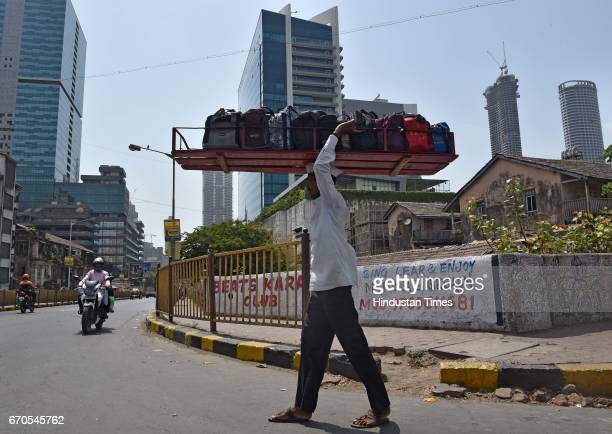 Dabbawala carrying lunches to deliver to the workplace at Lower Parel on April 17 2017 in Mumbai India Dabbawala is a person in India most commonly...